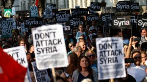Protesters listen to speeches during a rally against the proposed attack on Syria in central London August 28, 2013 (Reuters / Olivia Harris)