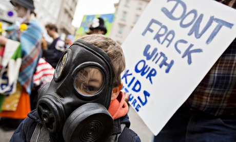 Fracking smell : A young boy wears a gas mask as anti fracking campaingers