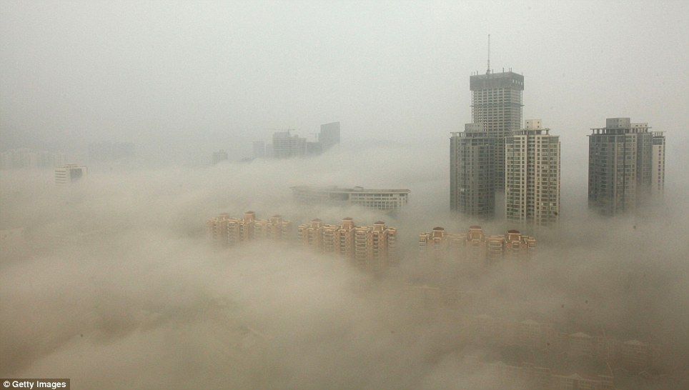 Grey pall: This photo shows buildings in the city of Lianyungang, where schools have had to be closed. State media was condemned for trying to put a positive spin on the problem