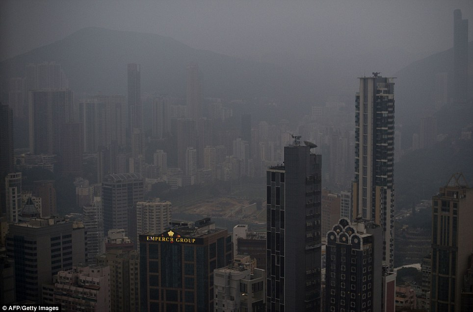 As the home of the world's fastest-growing economies, much of south east Asia is plagued by pollution. This photo shows haze hanging over downtown Hong Kong this week