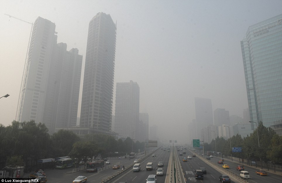 Superpower: Even on a normal day, many Chinese cities have dangerously high pollution levels. This photo of downtown Beijing was taken on November 2 this year