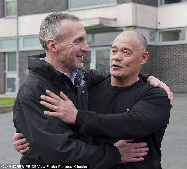 Steve Fong (right) and Kevin Edwards (left) embrace after seeing their abuser jailed decades after the attacks