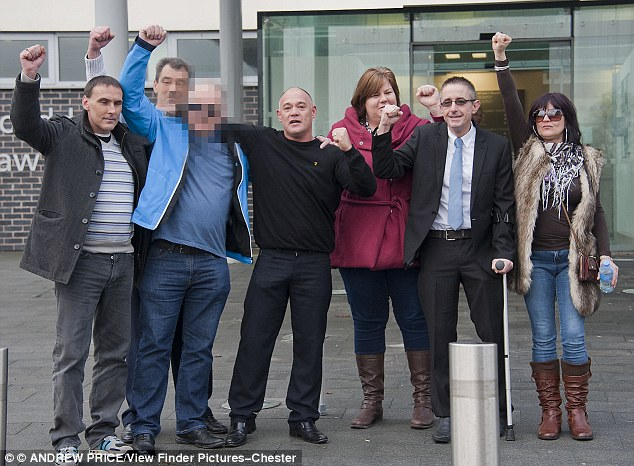 Punching the air in victory, the 73-year-old's victims and their families stand outside Mold Crown Court after seeing the paedophile sentenced to life behind bars for abusing them as children in north Wales