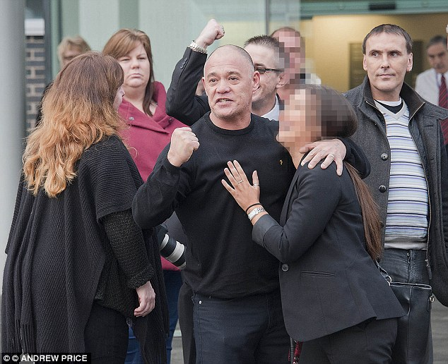 Stephen Fong (centre) celebrates outside court with family and fellow victims of paedophile John Allen after seeing the 73-year-old jailed for life