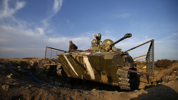 A Ukrainian serviceman is pictured next to an armored vehicle near the village of Debaltsevo in eastern Ukraine. (Reuters/David Mdzinarishvili)