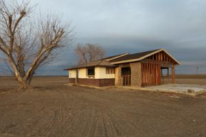 Many farmhouses in Bakersfield, California, have been…