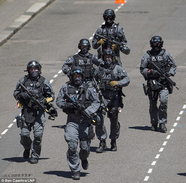 Security is being ramped up ahead of VJ Day celebrations in London next week following the revelation that home-grown jihadis are planning to murder the Queen (file photo of counter-terrorism training exercise)