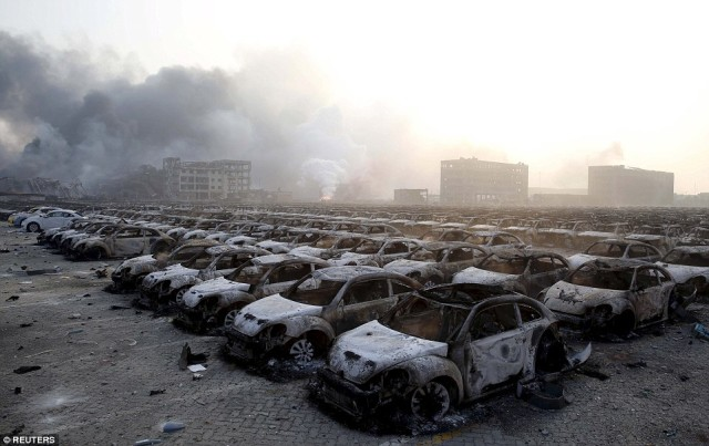 Thousands of burnt out Volkswagen Beetles close to ground zero in Tianjin.