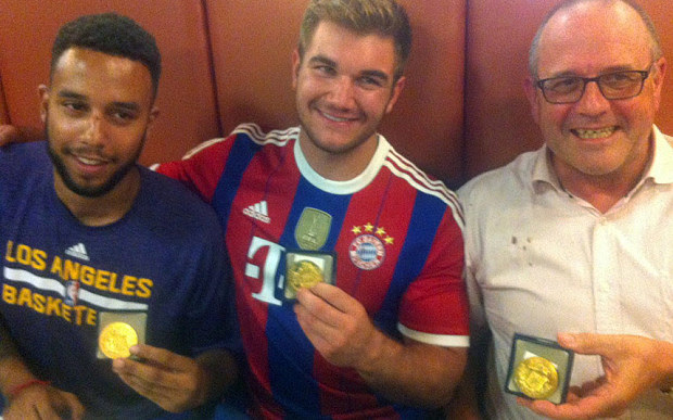 From left: Anthony Sadler, Alek Skarlatos and British national Chris Norman hold their medals as they sit in a restaurant after a brief ceremony in the town of Arras, northern France