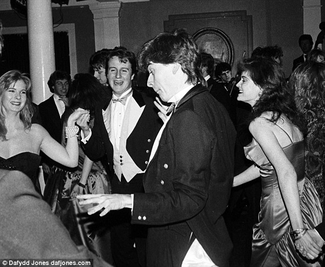 Party time: David Cameron (centre) dances at the Pitt Club Ball at Cambridge University in 1987