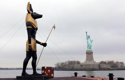 7-ton-replica-statue-of-the-egyptian-god-anubis-passes-by-the-statue-of-liberty-in-new-york.jpg
