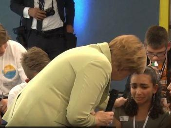 http://cdnph.upi.com/sh/th/i/UPI-1831437095160/2015/14371056346169/Merkel-tells-teary-eyed-Palestinian-girl-some-immigrants-have-to-go-back.jpg