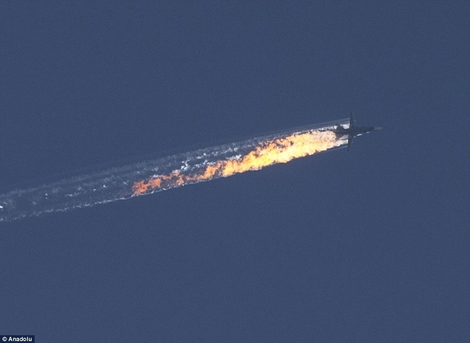This image shows the moment the Russian Sukhoi Su-24 jet was shot down by Turkish F-16 fighter planes near the Turkish-Syrian border, in Hatay, which has seen NATO call an 'extraordinary' meeting and Russian President Putin warn of 'serious consequences'