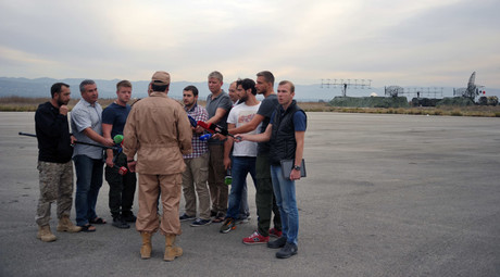 Rescued pilot of the Russian Air Force's Su-24 jet, Captain Konstantin Murakhtin, center, answers journalists' questions at Khmeimim Air Base in Latakia. © Dmitriy Vinogradov