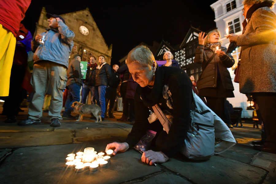 Jenna Kumiega from Shrewsbury lights a candle