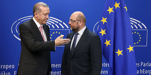 Turkey's President Tayyip Erdogan (L) poses with European Parliament President Martin Schulz ahead of a meeting at the EU Parliament in Brussels, Belgium October 5, 2015. Erdogan appeared to mock European Union overtures for help with its migration crisis as he arrived for a long-awaited state visit to Brussels and a string of meetings with EU leaders set to start on Monday. REUTERS/Francois Lenoir