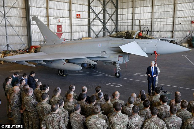 'War is a messy business': Defence Secretary Michael Fallon (pictured speaking to RAF personnel in front of a Typhoon at RAF Akrotiri in Cyprus) urged the public to be prepared for 'setbacks' in the campaign against ISIS