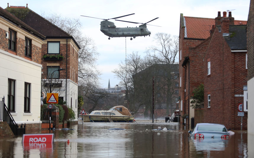 A Chinook helicopter delivers materials to repair to the flood defence systems in York, North Yorkshire