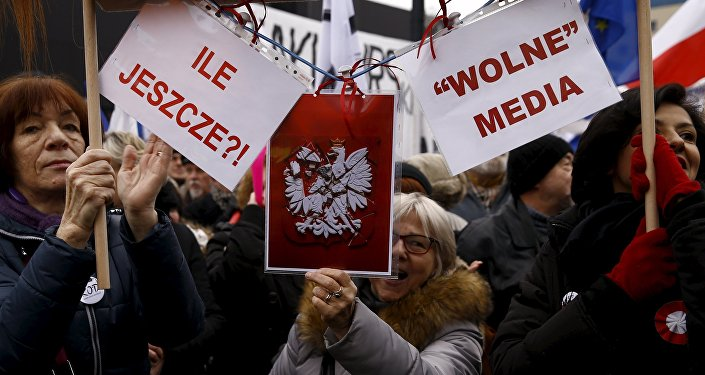 People gather during an anti-government demonstration for free media in front of the Polish television building in Warsaw, January 9, 2016