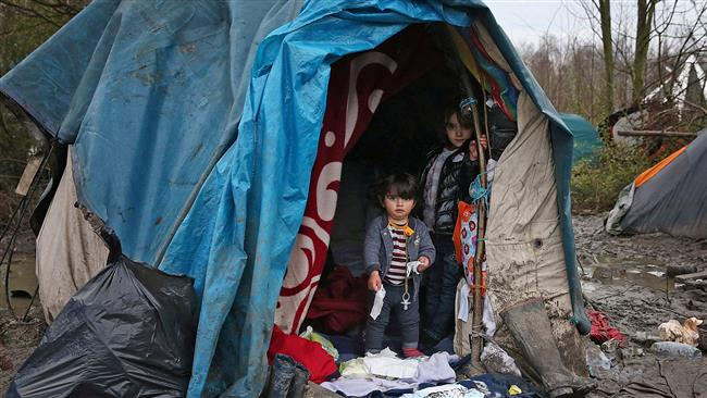 Displaced children in a French refugee camp