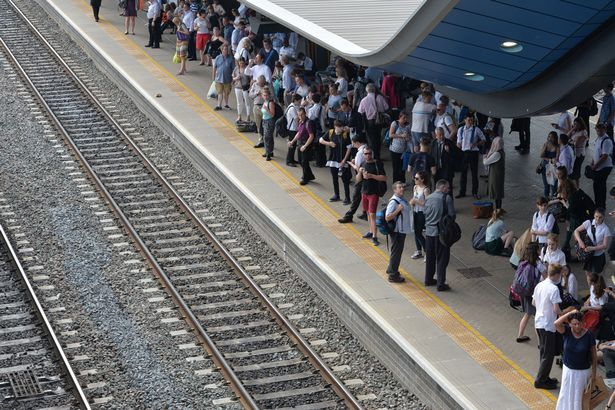 Passengers waiting for trains