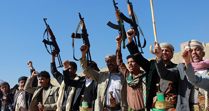 Supporters of Shiite Huthi rebels and militiamen shout slogans raising their weapons during a rally against the Saudi-led coalition, which has been leading the war against the Iran-backed rebels, on December 17, 2015 in Sanaa
