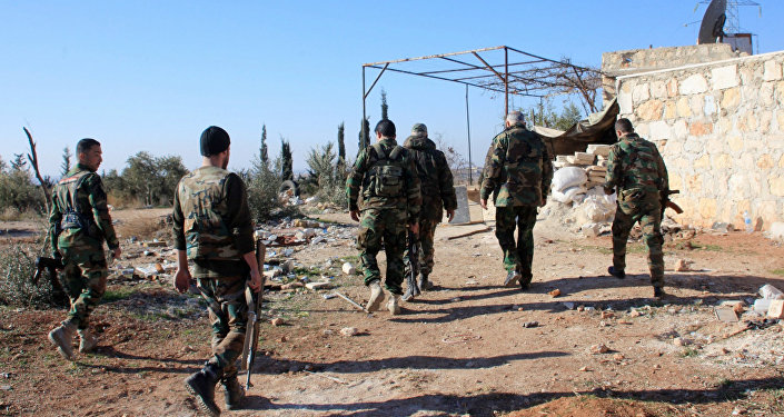 Syrian government forces inspect an area near the village of Khan Tuman, south from the provincial capital Aleppo, on December 22, 2015