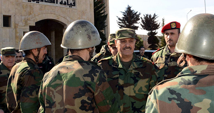 Syria's General Fahd Jassem al-Freij (C), Deputy Commander-in-Chief of the Army and the Armed Forces and Minister of Defense allegedly visiting troops in the northern Syrian city of Aleppo. (File)