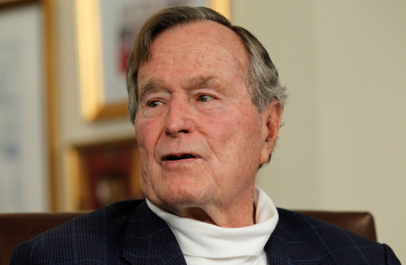HOUSTON, TX - MARCH 29: Former President George H.W. Bush talks with Republican presidential candidate, former Massachusetts Gov. Mitt Romney at Bush's office on March 29, 2012 in Houston, Texas. Mitt Romney received an endorsement from Former President George H.W. Bush and Barbara Bush during the meeting. (Photo by Tom Pennington/Getty Images)