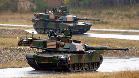 U.S. Soldiers take part in an exercise in M1A2 Abrams tanks, alongside NATO allies at the Joint Multinational Training Command in Grafenwoehr November 18, 2014. © Michael Dalder