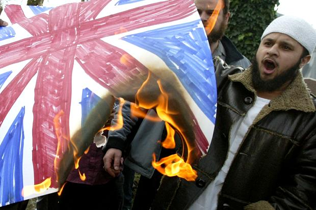 Islamist extremists burn a makeshift Union Jack in London in 2004
