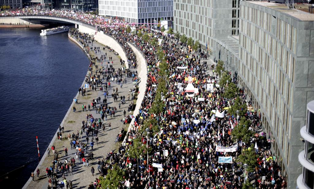Tens of thousands of protestors attend a demonstration against the free trade agreements TTIP (Transatlantic Trade and Investment Partnership) and CETA (Comprehensive Economic and Trade Agreement) in Berlin, Germany, Saturday, Oct. 10, 2015. (AP Photo/Markus Schreiber)