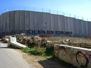 """A section of the barrier -- erected by Israeli officials to prevent the passage of Palestinians -- with graffiti using President John F. Kennedy's famous quote when facing the Berlin Wall, """"Ich bin ein Berliner."""" (Photo credit: Marc Venezia)"""