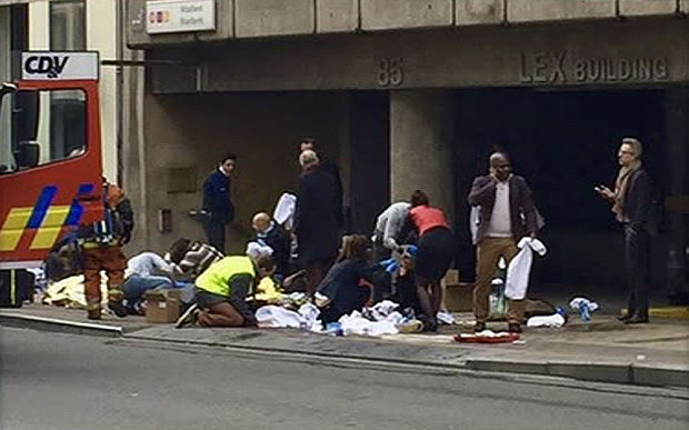 Treating the injured outside a Brussels Metro station
