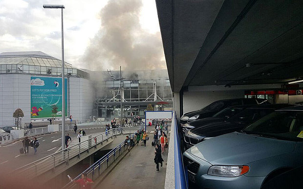 A plume of smoke rises over Brussels airport after an explosion
