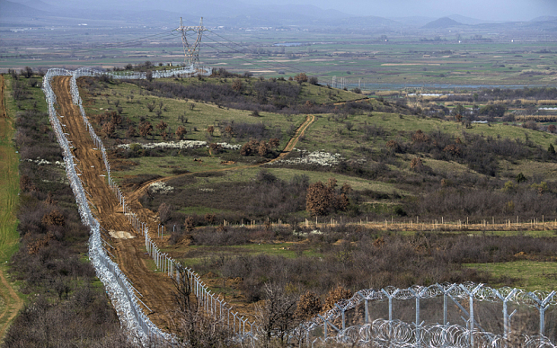 A view of the barbed wire fence along the Greek-Macedonia border