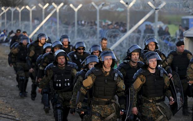 Macedonian riot policemen patrol at the Macedonian-Greek border in Gevgelija, Macedonia