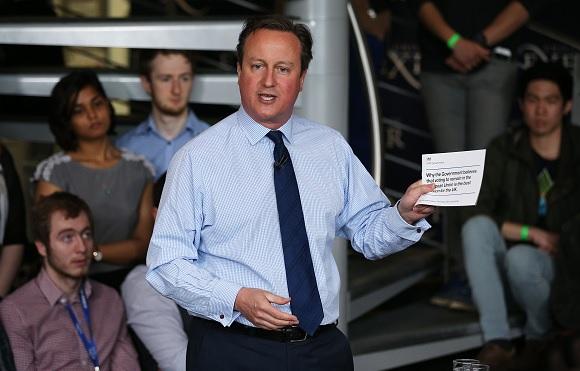 Cameron holds pro-EU leaflet