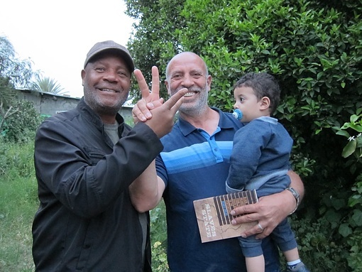Emory Douglas, BPP Minister of Culture, with Mukhles Burgal an