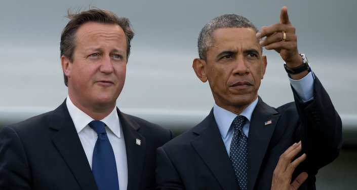 US President Barack Obama, right, stands alongside British Prime Minister David Cameron