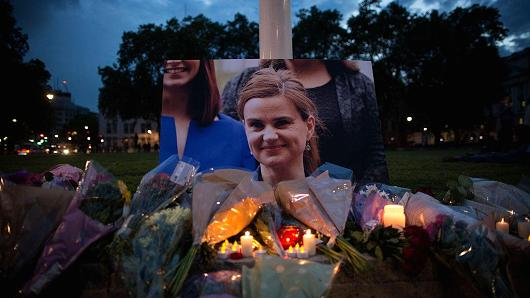 Flowers surround a picture of Jo Cox during a vigil in Parliament Square on June 16, 2016 in London, United Kingdom.