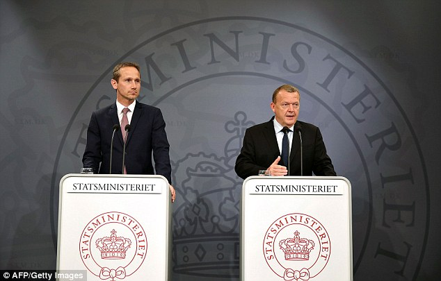 Danish prime minister Lars Loekke Rasmussen (R) and Danish foreign minister Kristian Jensen speak to media after Britain's voted to leave the European Union