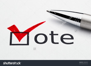 stock-photo-red-checkmark-on-vote-checkbox-pen-lying-on-ballot-paper-concept-for-voter-registration-and-18800809