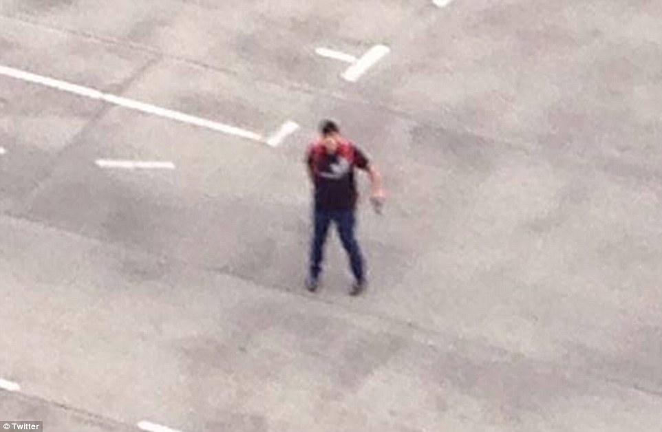 The gunman's body has been found half a mile from the scene after he reportedly turned the gun on himself. Police now believe he may have acted alone, after they initially went in search of three gunmen