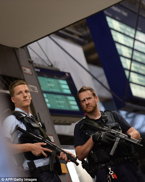 Police secures the main train station following shootings at a shopping mall