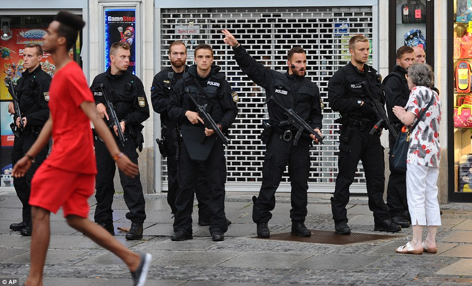 Chief of Munich Police Marcus Dagloria Martins said: 'We are at the moment after three attackers. We have about 100 people on site and we are trying to evacuate people from the site. Our priority is to catch the attackers at this stage and then we will inform you again'