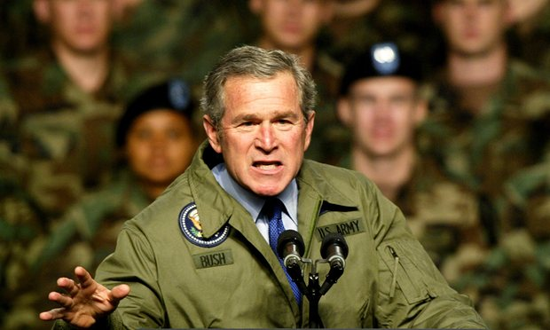 President George W Bush speaks to American soldiers 2003, a few week before invading Iraq. Photograph: Jeff Mitchell/Reuters