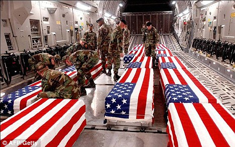 PHOTO: Offloading coffins of US soldiers killed in Iraq at Dover Air Base in Delaware. 4,486 U.S. soldiers died in Iraq and 2,345 U.S. soldiers died in Afghanistan, 1 million U.S. soldiers wounded in both wars, and a potential cost of up to $6 trillion.