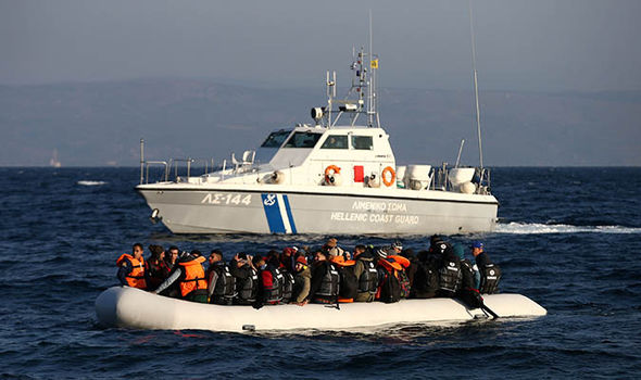 A coast guard boat rescues refugees from the sea off Greece