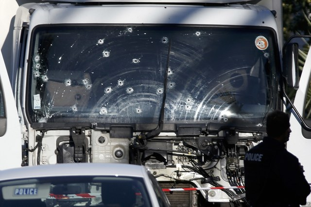 Bullet imacts are seen on the heavy truck the day after it ran into a crowd at high speed killing scores celebrating the Bastille Day July 14 national holiday on the Promenade des Anglais in Nice, France, July 15, 2016. REUTERS/Eric Gaillard